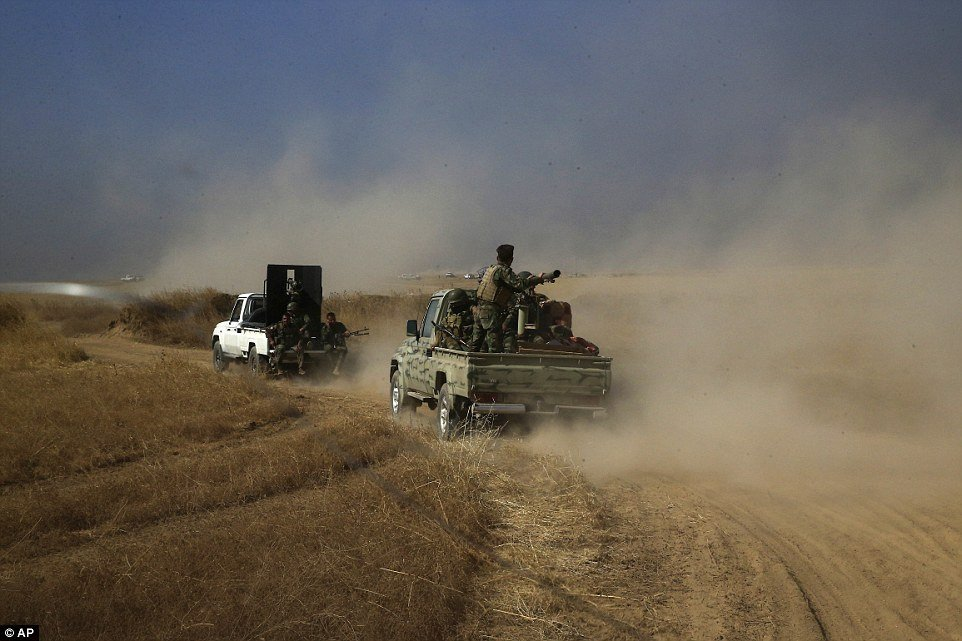 A Peshmerga convoy drives towards a frontline in Khazer,east of Mosul as the battle to liberate the city from ISIS began