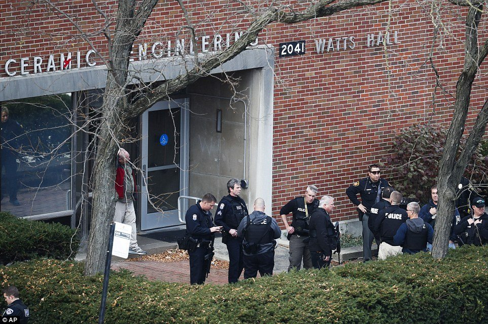 3ad50b3d00000578-3978944-police_gather_outside_of_watts_hall_on_monday_after_the_assailan-a-2_1480371621329